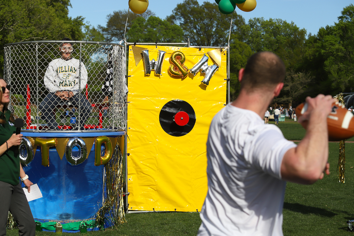 A captain of the football team gets ready to dunk Dan Cristol.